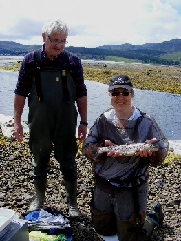Billy Forbes and Karen Starr with a 435mm trout from the mouth of the River Carron