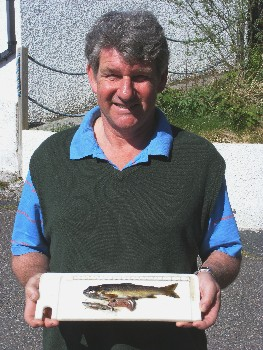 Mark Williams with the Brown trout and partly digested minnow from Sguod