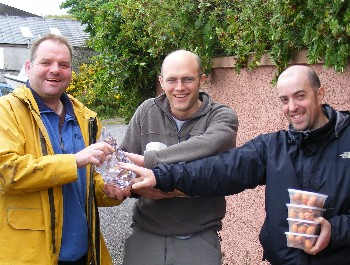 Iain McWhinney presenting RAFTS Challenge Trophy to James Hunt and Kenny Gault
