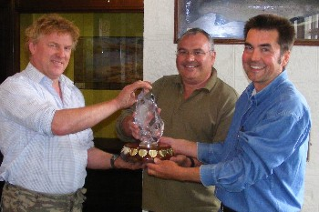 Carl Forbes & Nick Benge recieving the trophy from Loch Maree Hotel Ghillie, Fred Robertson.