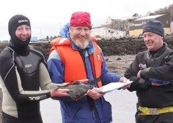 Peter, Roger and Garry with a flounder which was also in the sample (photo by Ben Rushbrooke)!